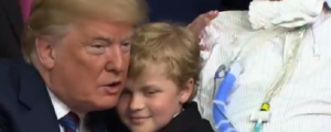 Trump hugs child