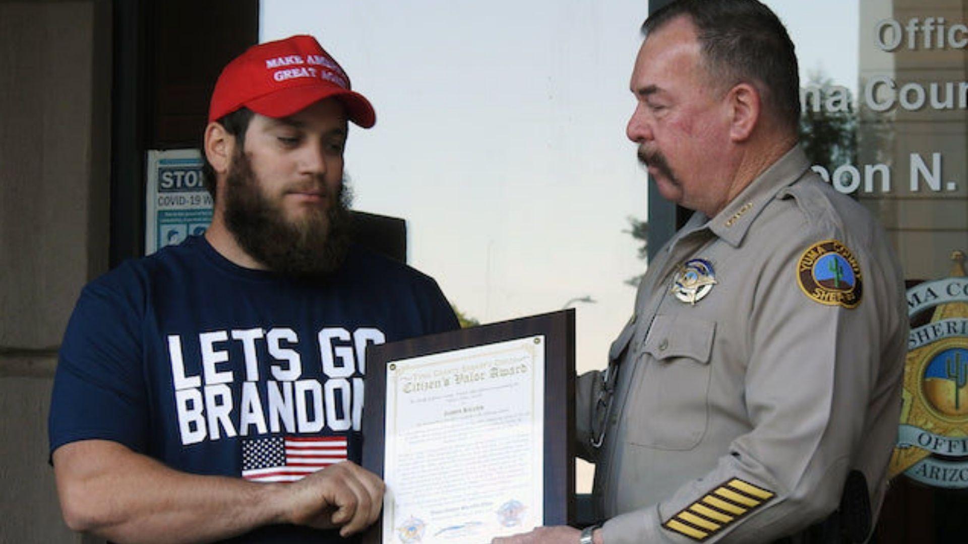Marine Veteran Wears 'Let's Go Brandon' Shirt To Receive Valor Award For Disarming Robbery Suspect